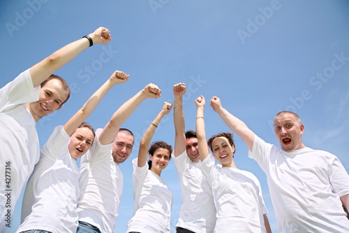 group of people with hands up