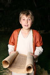 Boy reading a scroll