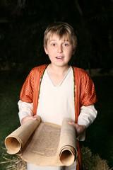 Boy reading a scroll
