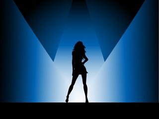 Sexy female in spotlight