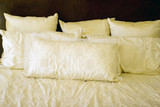 White bed with pillows poster