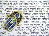 Fototapety Blue Hamsa kabala good luck charm on Hebrew bible