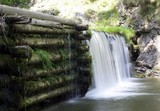 The big beautiful waterfall on wooden weir , long exposure poster