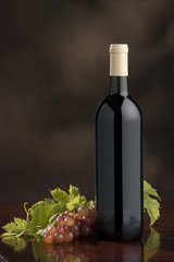 wine bottle with grapes and leaves