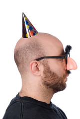 Man with fake nose and party hat