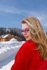 Pretty girl on winter scenic background