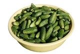 green gherkins in big basin on white background poster