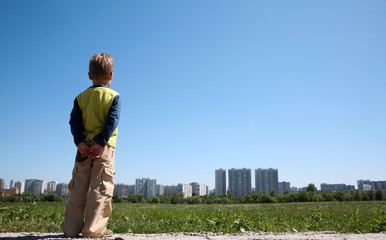 boy looking at the town