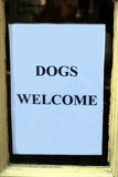 sign. dogs welcome sign poster