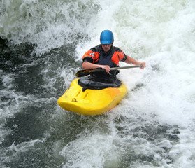 Man Paddling his Kayak on Whitewater Rapids