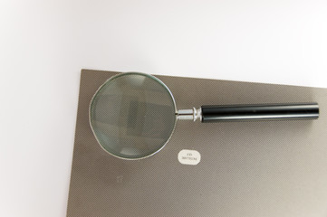 Magnifying glass on texture