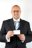 Cheerful businessman holding a business card