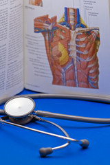 Stethoscope and a medical book