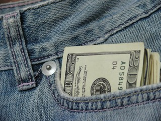 Pocket money, dollars banknote in jeans pocket, close up