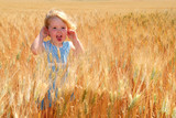 Happy Girl in Durum Wheat Field poster