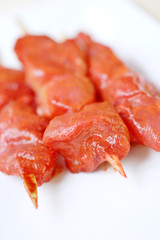 raw chicken kebabs marinated in a chinese sauce