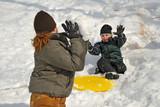 Children having snowball fight poster