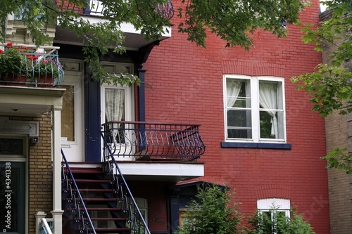 red brick apartments with typical balconies in montreal by