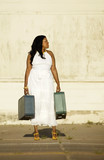 African American woman with suitcases