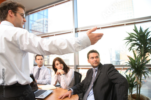 Man speaks in front of colleagues