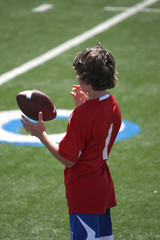 Boy tossing football