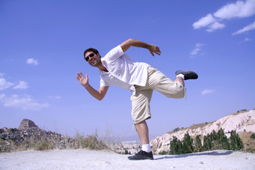 healthy happy man jumping in joy of life