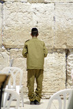 israeli soldier praying at the wailing western wall, jerusalem, poster