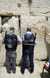 police officers praying at the wailing western wall, jerusalem, poster