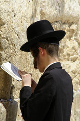 young hasidic jew at the wailing western wall, jerusalem, israel