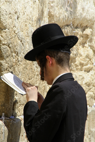 poster of young hasidic jew at the wailing western wall, jerusalem, israel