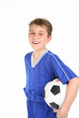 Happy boy holding soccer ball