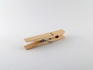 An isolated wooden clothespin