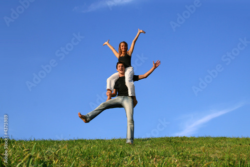 Happy boy and girl in a meadow