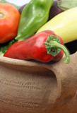 peppers in a clay pot poster