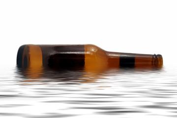 Brown beer bottle laying in water