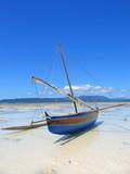 Detail of a fisherman boat laying on a beach, Nosy Iranja