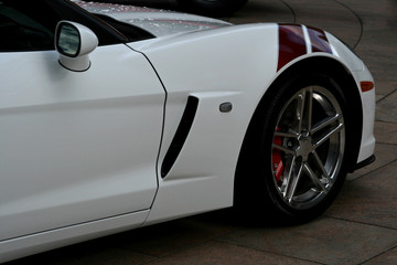 side of white supercar