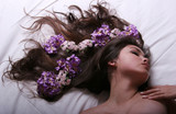 Pretty woman with flowers sleeping poster