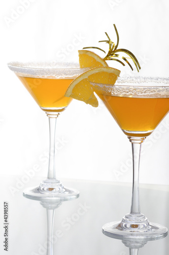 martini glass with orange cocktail and piece of citrus 9