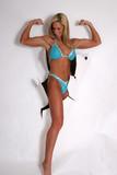 Emerging woman flexing poster