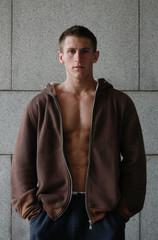 Muscular Man Wearing a Brown Jacket