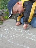 child drawing a chalk on asphalt poster