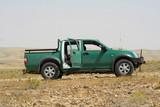 green pickup truck, in sede boker desert, israel poster