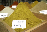 mountain of curry on display in local spice store poster