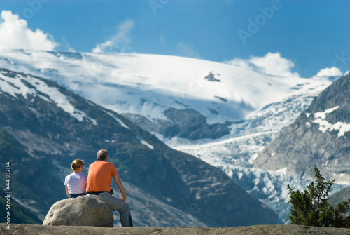 Elderly couple taking a rest in fron of marvelous landscape
