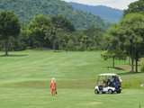 Caddie and golf cart on the fairway poster