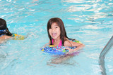 Five year old girl excited about swimming poster