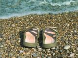 Pair of slipper on beach poster