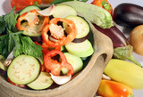 frsh sliced vegetables in a clay pot poster