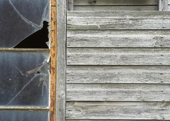 Weathered Wooden Outhouse